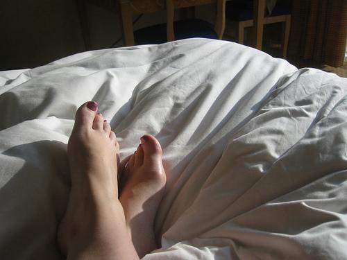 Feet in the light and shadows